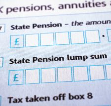 Taxation and finance concept, forms, UK tax form in close-up for state pension